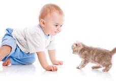 Child with kitten Stock Photos