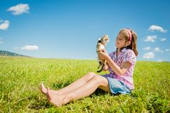 Child with kitten Stock Image