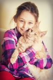 Child and kitten. Maine coon Royalty Free Stock Photo