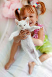 Child with kitty Stock Image