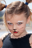 child with kitty cat make up. Serious girl with a kitty cat make up Stock Photography