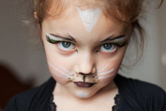 child with kitty cat make up Stock Photo