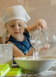 Child knead the dough in a kerchief Stock Photo