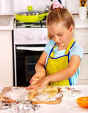 Child knead dough at kitchen. Royalty Free Stock Photo