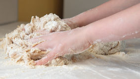 Child Kneading Dough Royalty Free Stock Photography