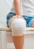Child knee with adhesive bandage. Stock Photos