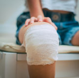 Child knee with adhesive bandage. Royalty Free Stock Images