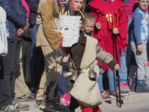 Child Kurent. Child wearing homemade Kurent costume runs in front of the crowd royalty free stock images