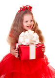 Child l in red dress with gift box. Stock Photography
