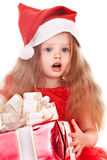 Child l in red dress with gift box. Royalty Free Stock Images