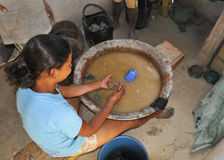 Child Labor. A young girl working in handcraft pieces in poor interior of Brazil Royalty Free Stock Photo