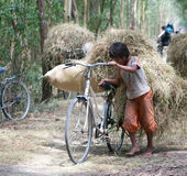Child labor at Asia countryside Royalty Free Stock Photo