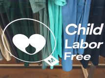 Child labor free textile clothing shop. Child labor free mark. Products certified with the mark provides assurance that brands carrying it are ethically stock photo