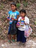 Child Labor Honduras. COPAN RUINAS MAYA/HONDURAS - CIRCA MARCH 2012: Children selling local artworks in Copan Ruinas May. Child labor in Honduras is related to royalty free stock photos