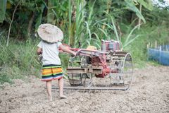 Child labor, Poor children driving a plow farming area, Children have to work because of poverty, World Day Against Child Labour. Child labor, children are royalty free stock image