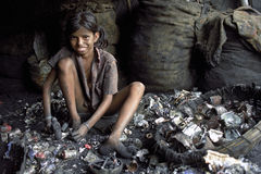 Child labor in recycling of batteries, Bangladesh Royalty Free Stock Photo