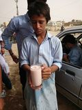 Child serving Thadhal drink stock images