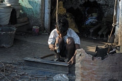 Child Labour. A child labour hard working at the road side shop Royalty Free Stock Photography