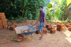 Child labour in india. Poor little Indian boy  in a brick field workshop, illegal child labour Royalty Free Stock Photo