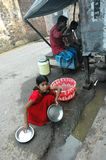 Child Labour In India. Kolkata,West Bengal-India-SOMA working at the road side eating stall Stock Image