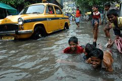 Child Labour In India. Kolkata,West Bengal-India-A group of child labour making fun in poisonus rain water logged street during rainy season in the slam aria of Royalty Free Stock Image