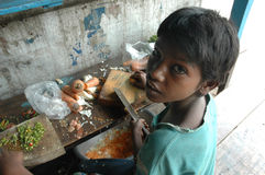 Child Labour In India. Kolkata,West Bengal-India-BABLU working on the road side eating stall of Kolkata.His father is a Rickshaw puller on the Kolkata roadwayes Stock Image