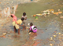 Child Labour In India. A group of child labour collect Some Money In Ganga River At Haridwar.(Uttarakhand).India Stock Photo