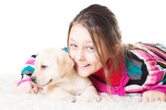 Child and labrador puppy Royalty Free Stock Photos