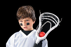 Child Lacrosse Player. A sweaty young boy poses with his lacrosse stick (crosse) after a game Stock Photos