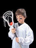 Child Lacrosse Player. A sweaty young boy poses with his lacrosse stick (crosse) after a game Royalty Free Stock Photos