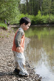 Child by lake Royalty Free Stock Photography