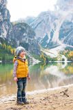Child on lake braies in south tyrol, italy Royalty Free Stock Images