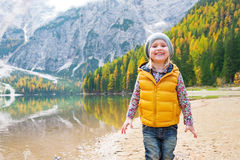 Child on lake braies in south tyrol, italy Stock Images