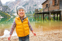 Child on lake braies in south tyrol, italy Stock Photos