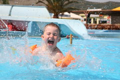The child laps in an aquapark. Stock Photo
