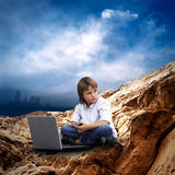 Child with laptop Royalty Free Stock Images