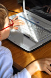 Child and laptop Royalty Free Stock Photos