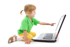 Child with laptop Stock Images