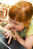 Child with laptop Royalty Free Stock Photo