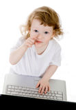 Child and laptop Stock Images