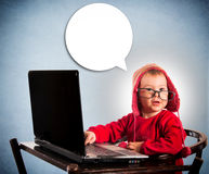 Child with laptop computer Stock Photo