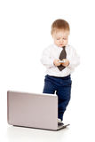 Child with laptop and mobile phone Royalty Free Stock Image