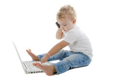 Child with laptop and mobile phone Royalty Free Stock Images