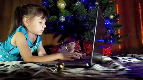 Child with laptop in the New Year. stock video