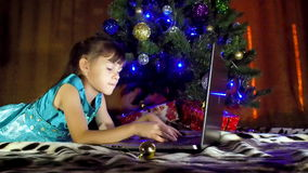 Child with laptop in the New Year. stock video footage