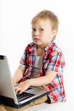 Child with a laptop. studio Royalty Free Stock Image