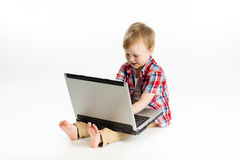 Child with a laptop. studio Stock Image