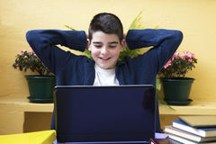 Child with laptop. Studying and smiling child with laptop Stock Image