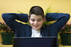 Child with laptop. Studying and smiling child with laptop Stock Photos