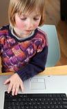 Child laptop working stock photos